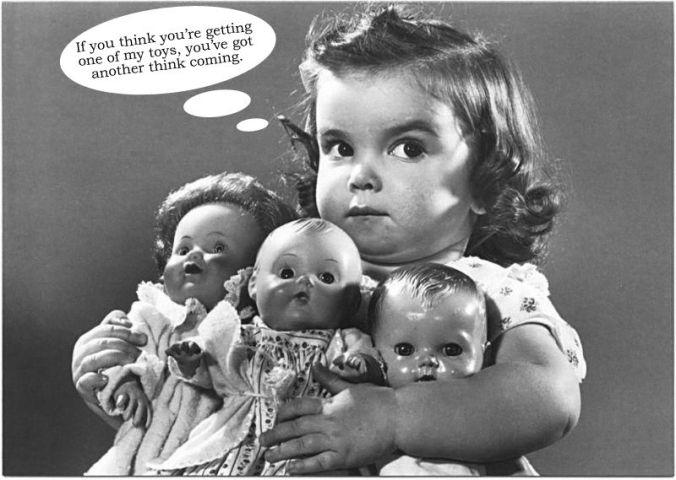 selfish girl with dolls